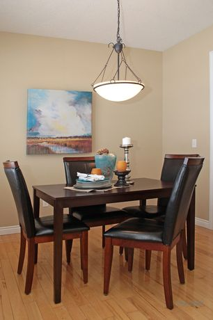 Traditional Dining Room with Hardwood floors, Pendant light