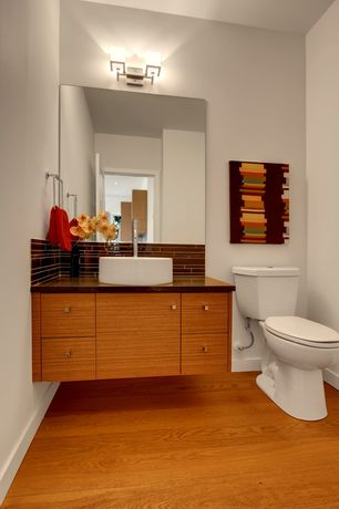 Contemporary Powder Room with European Cabinets, Flush, Subway Tile, Laminate floors, Standard height, Vessel sink