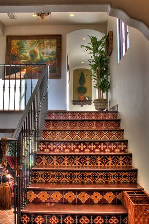 Eclectic Staircase with Laminate floors, Tile stair risers, High ceiling, Colored crystal chandelier, curved staircase