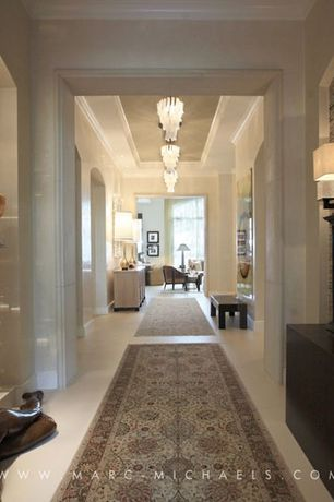 Traditional Hallway with Wall sconce, Crown molding, Standard height, Chandelier, Built-in bookshelf, can lights