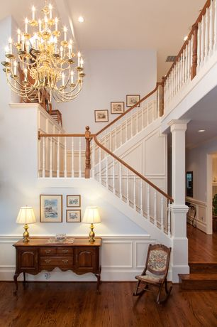 Traditional Staircase with Built-in bookshelf, Cathedral ceiling, Chandelier, Wainscotting, Hardwood floors, Chair rail