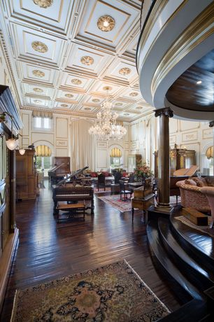Traditional Great Room with Hardwood floors, Chandelier, Arched window, Columns, French doors, Paint, High ceiling, Loft