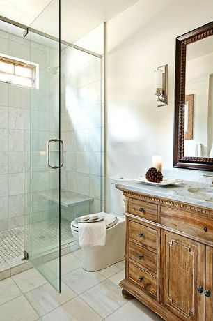 "Traditional 3/4 Bathroom with complex marble tile floors, Complex marble counters, 12"" x 12"" Carrera Marble Tile, Wall sconce"