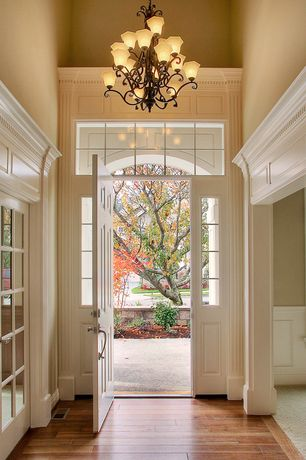 Traditional Entryway with Jatoba - Jatoba Natural 3 1/2 in. Solid Hardwood Plank, Transom window, Chandelier, French doors