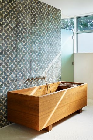 Tropical Master Bathroom with Studio Nendo Rectangular bathtub in wood