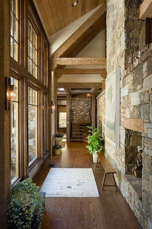 Craftsman Hallway with can lights, picture window, Oak - warm carmel solid hardwood plank, Fireplace, Hardwood floors