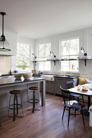 Eclectic Great Room with Window seat, Built-in bookshelf, Hardwood floors, Pendant light