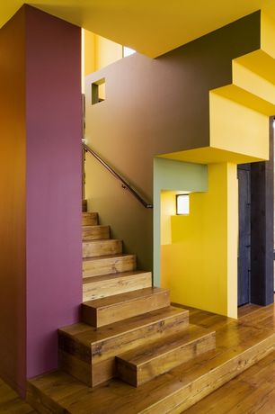 Contemporary Staircase with Hardwood floors, High ceiling, Columns