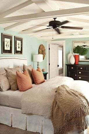 Cottage Guest Bedroom with Accent pillows, Painted dresser, Vases, Ceiling fan, Exposed beam, Framed mirror, Bedskirt
