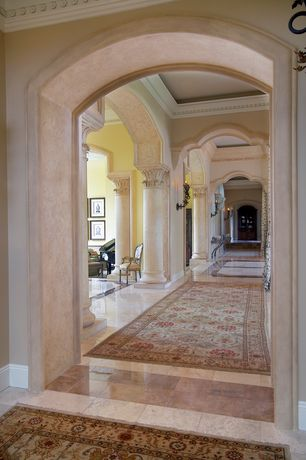 Mediterranean Hallway with Wall sconce, High ceiling, Crown molding, complex marble floors, Columns