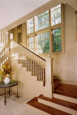 Traditional Staircase with Hardwood floors, Cathedral ceiling, Loft