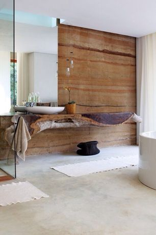Rustic Full Bathroom with Pendant light, Bathtub, Vessel sink, Skylight, Freestanding, Full Bath, Concrete floors, Shower