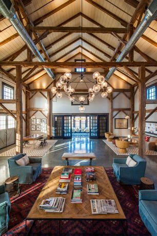 Rustic Great Room with Columns, Exposed beam, High ceiling, French doors, Chandelier, Pendant light, Concrete floors