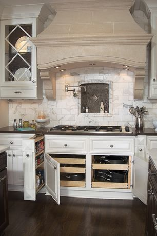 Traditional Kitchen with Framed Partial Panel, full backsplash, Simple Marble Tile, Simple granite counters, can lights