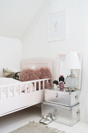 Eclectic Kids Bedroom with Hardwood floors, Table lamp, Pink toddler bed, Woven rug, Traditional toddler bed, pastel pink