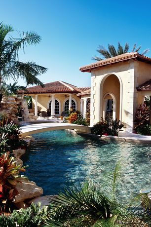 Mediterranean Swimming Pool with exterior stone floors, Fountain, Arched window, Other Pool Type