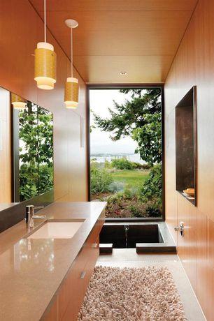 Contemporary Master Bathroom with Soapstone, Pendant light, Standard height, Bathtub, Limestone counters, limestone floors
