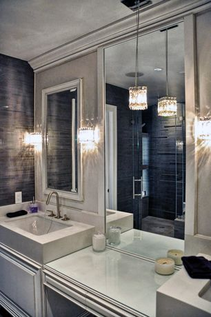 Contemporary Master Bathroom with Wall sconce, Pendant light, Limestone counters, Raised panel, Double sink, Master bathroom