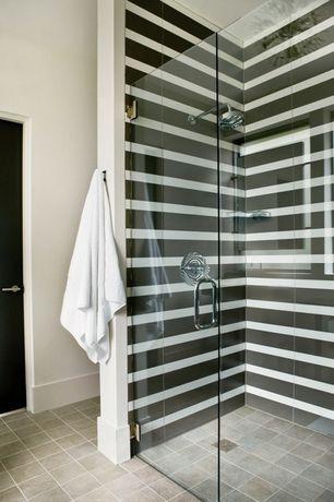 Modern Master Bathroom with Daltile ayers rock majestic mound glazed porcelain, frameless showerdoor, Master bathroom