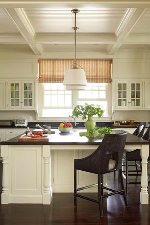 Traditional Kitchen with Casement, partial backsplash, Inset cabinets, Wood counters, Pendant light, Standard height
