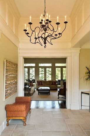 Traditional Hallway with simple marble tile floors, Chandelier, High ceiling, Wainscotting