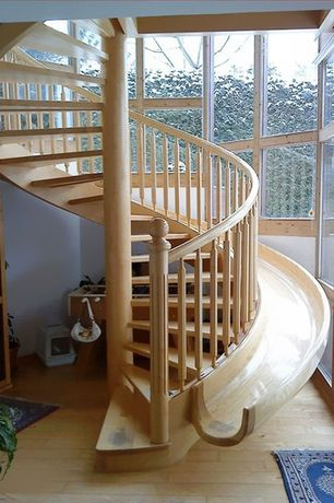 Contemporary Staircase with Stair slide, Wood floors, Area rug