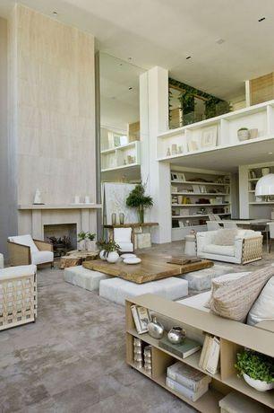 Contemporary Living Room with Columns, limestone tile floors, Fireplace, Built-in bookshelf, stone tile floors, High ceiling