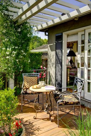 Cottage Deck with Trellis, Weather treated decking, Metal bistro table and chairs, Lipari Mosaic Outdoor Bistro Table