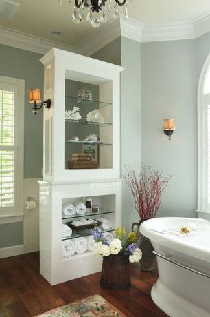 Contemporary Full Bathroom with linen and towel storage cabinet, Casement, Standard height, Crown molding, Paint, Wall sconce