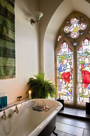 Eclectic Master Bathroom with stone tile floors, Bathtub, Stained glass window, slate tile floors, High ceiling, Clawfoot