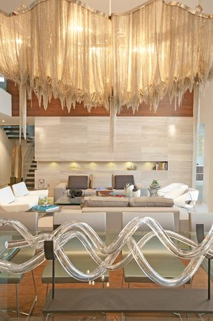 Contemporary Dining Room with Chandelier, Hardwood floors, Standard height