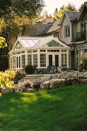 Traditional Exterior of Home with Pathway, Transom window, Raised beds, French doors, Sun room, specialty window