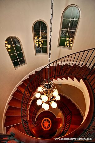 Traditional Staircase with Chandelier, Hardwood floors, Arched window, Spiral staircase, Cathedral ceiling