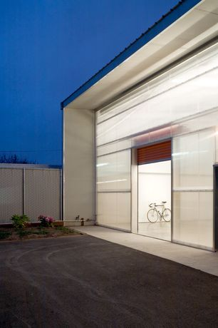 Contemporary Garage with Concrete floors, High ceiling