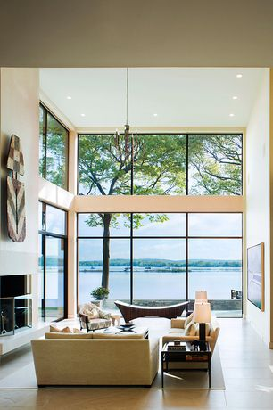 Modern Living Room with Chandelier, French doors, High ceiling, Concrete tile
