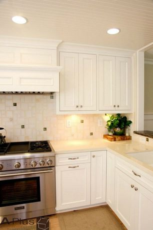 Cottage Kitchen with Stone Tile, L-shaped, Hardwood floors, 2 in. Solid Surface Countertop Smple in Bisque, Custom hood
