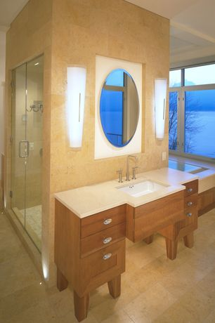 Modern Master Bathroom with Corian counters, Wall Tiles, Shower, Undermount sink, stone tile floors, Wall sconce, Casement