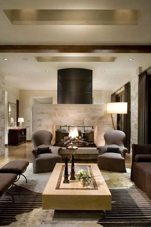 Contemporary Living Room with Standard height, Hardwood floors, Fireplace, stone fireplace, sliding glass door, Exposed beam