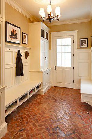 Traditional Mud Room with Crown molding, Brick floors, Chandelier, Glass panel door, Built-in bookshelf