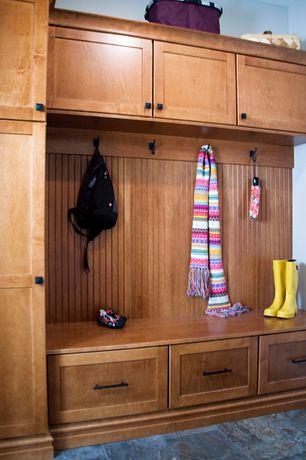 Craftsman Mud Room with Built-in bookshelf, travertine floors