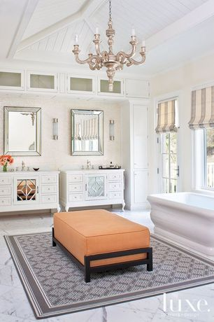 Cottage Master Bathroom with Chandelier, Freestanding, Maax Roman Free Standing Soaker Tub, Wall sconce, Flat panel cabinets