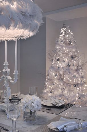 Contemporary Dining Room with Large feather chandelier, Winter Park Full Pre-lit Christmas Tree, Acanthus leaf candelabra