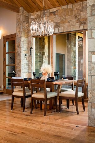 Contemporary Dining Room with French doors, Exposed beam, Chandelier, picture window, Hardwood floors, High ceiling