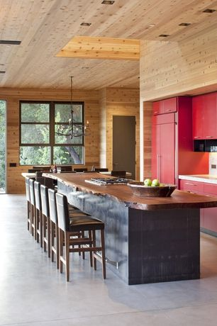 Contemporary Kitchen with Chandelier, Poured concrete floors, Paint 1, High ceiling, Breakfast bar, Casement, full backsplash