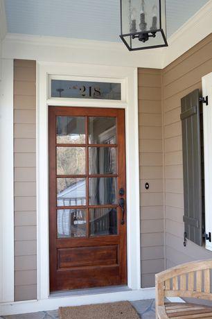 Country Front Door with exterior stone floors, Glass panel door, Transom window