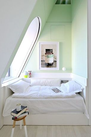 Contemporary Guest Bedroom with Pottery barn classic down comforter, Paint dipped stool, Skylight, Laminate floors