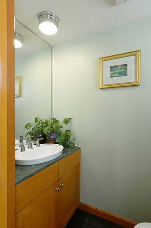 Modern Powder Room with Standard height, flush light, Flat panel cabinets, Complex granite counters, slate tile floors, Flush