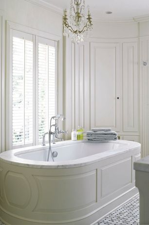"Traditional Master Bathroom with Complex marble counters, Smith & Noble Custom 3 1/2"" Durawood Shutters In White, Chandelier"