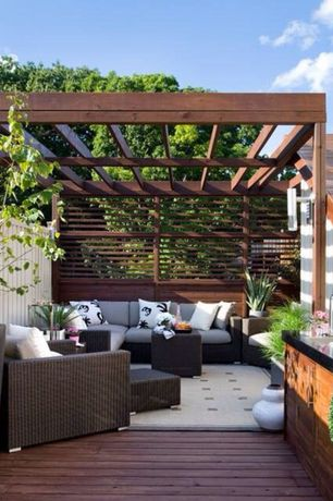 Contemporary Patio with Lowe's 0.625-in x 1.375-in x 96-in Kiln-Dried Redwood Board, Trellis, Fence