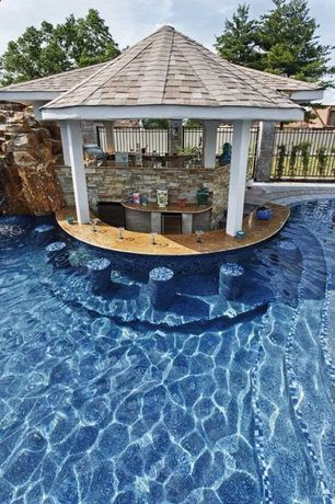 Contemporary Swimming Pool with Infinity pool, Pathway, Fence, exterior stone floors, Custom Pool Built-in, Outdoor kitchen